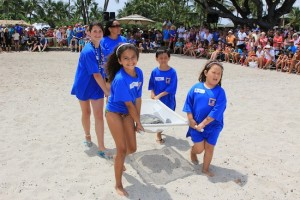 Cindi Punihaole and keiki release a honu (photo courtesy of Mauna Lani Bay Hotel)