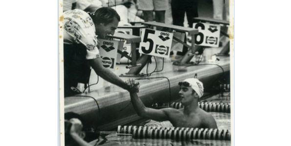 Steve Borowski congratulates his swimmer (photo courtesy of Jennifer Stabrylla).