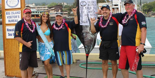 Game Fishing Club of Australia's Rolf Czabayski put the first marlin points on the board Monday during the first day of fishing. With him are teammates Ralph Czabayski, Steve Morris and Russell Bianco, and Miss Billfish Cheynielle Pacheco. (Hawaii 24/7 photo by Karin Stanton)