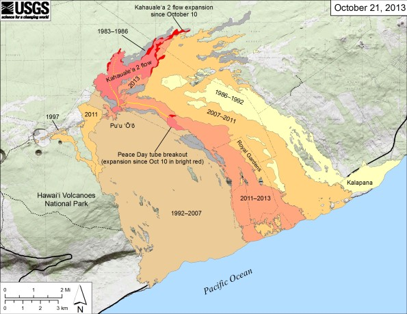 Small-scale map showing Kīlauea's east rift zone flow field as of October 21, 2013. The Peace Day flow (light orange), remains active…barely. One small breakout continues to leak from the tube on the upper flow field. The tube below this point has likely been abandoned, and no lava is reaching the coastal plain or entering the ocean. Near Puʻu ʻŌʻō, the Kahaualeʻa 2 flow is still active northeast of Puʻu ʻŌʻō. The Kahaualeʻa 2 flow and the breakout from the Peace Day tube as of October 10 are shown in pink, while expansion of both flows as of October 21 are shown in red. Older lava flows are labeled with the years in which they were active: episodes 1–48b flows (1983–1986) are shown in gray; episodes 48c–49 flows (1986–1992) are pale yellow; episodes 50–55 flows (1992–2007) are tan; and episodes 58–60 flows (2007–2011) are pale orange. The active lava tubes are shown with yellow lines. Map courtesy of USGS/HVO