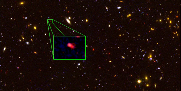 This image from the Hubble Space Telescope CANDELS survey highlights the most distant galaxy in the universe with a measured distance, dubbed z8_GND_5296. The galaxy's red color alerted astronomers that it was likely extremely far away, and thus seen at an early time after the Big Bang. (Image courtesy of V. Tilvi, S.L. Finkelstein, C. Papovich, A. Koekemoer, CANDELS and STSCI/NASA)