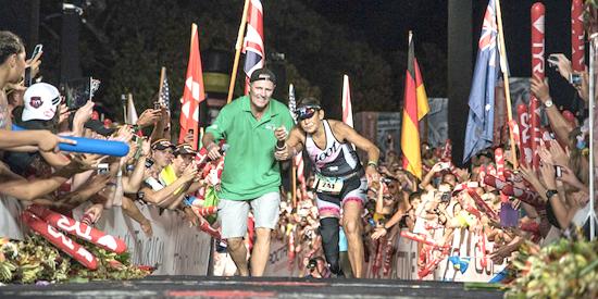 Mike Reilly greets Karen Aydelott at the finish line. (Photo courtesy of Nils Nilsen)
