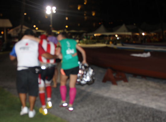 A late night finisher needs a little post-race assistance from the medical staff. (Hawaii 24/7 photo by Karin Stanton)