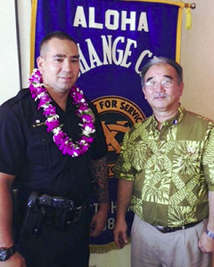 Aloha Exchange Club President Jay Kimura is seen with 'Officer of the Month' Shea Nactor.