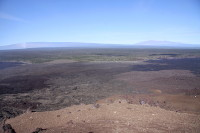 It was remarkably clear during Wednesday's (Nov 27) overflight of Kīlauea's east rift zone. This photo is taken from Puʻu ʻŌʻō, and looks northwest. Mauna Kea is at the right, and Mauna Loa is at the left. In front of the summit of Mauna Loa, the degassing plume from the lava lake at Kīlauea's summit is rising vertically. Photo courtesy of USGS/HVO
