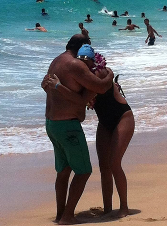 Charlie Camacho and daughter Leahi at Sandy Beach after she completed the 26-mile trek. (Photo courtesy of Paul Johnson)