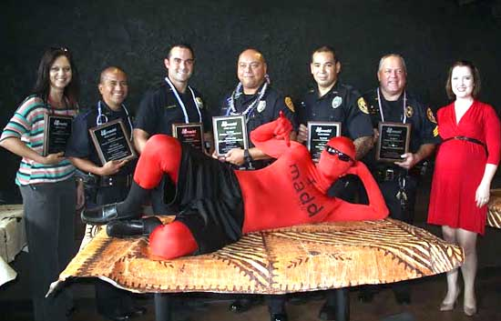 From left: Cynthia Honma of Hilo – Community Service Award; Officer Keith Nacis – Traffic Enforcement Unit I; Officer Nicholas McDaniel – Kona Patrol; Officer Christopher Kapua-Allison – Top Cop: South Hilo Patrol; Officer Shea Nactor – Puna Patrol; Sgt. Christopher Gali – Community Service Award; Executive Director Abigail Nickell – MADD Hawaii. (Photo courtesy of MADD Hawaii)