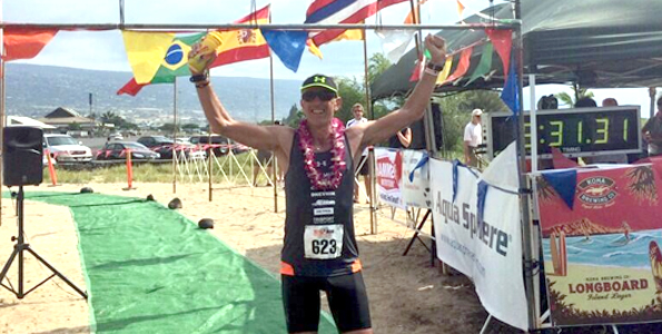 Miro Kregar crosses the finish line Sunday, winning his first Ultraman World Championships. (Photo courtesy of Miro Kregar)