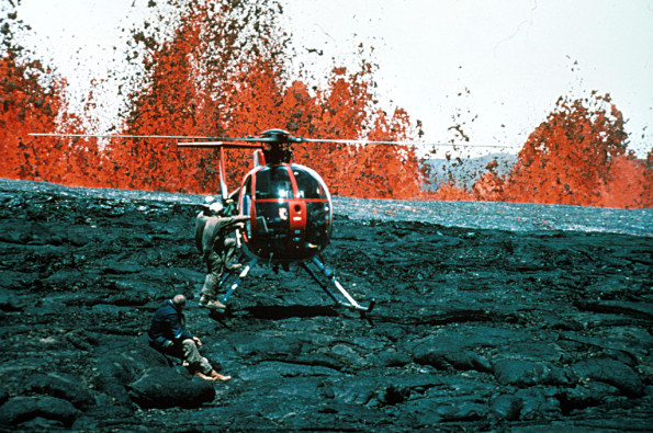 Hawaii Volcanoes National Park. 1984 eruption of Mauna Loa Volcano. Hawaiian Volcano Observatory geologists at lava fountains. Helicopters provided access to remote areas of the eruption and were essential for safety. Photo by R.B. Moore, 1984. Photo courtesy of USGS