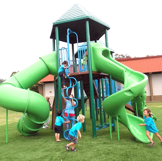 Keiki enjoy the new playground at Honokaa Park. (Photo courtesy of Department of Parks and Recreation)