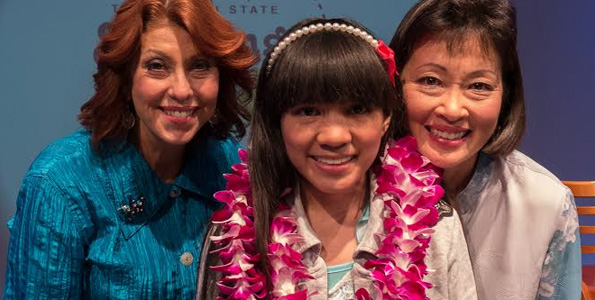 From left: PBS president / CEO Leslie Wilcox; Christianne Abella, 2014 aio Hawaii State Spelling Bee Champion; Susan Eichor, aio President and Chief Operating Officer. (Photo courtesy of PBS Hawaii)