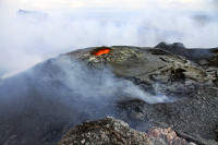 The northeast spatter cone in Puʻu ʻŌʻō crater remained active on April 28, 2014, but the lava pond has crusted over, leaving only a small circular opening venting gas. Photo courtesy of USGS/HVO