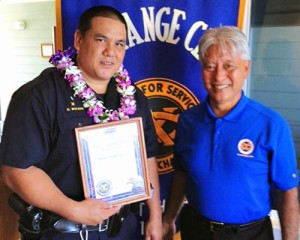 Hilo Exchange Club President Andy Iwashita presents an 'Officer of the Month' award to Officer Dwight Walker.