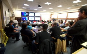 Officials being briefed by the Central Pacific Hurricane Center at Hawaii County Civil Defense Friday morning (Aug 8). Photography by Baron Sekiya | Hawaii 24/7
