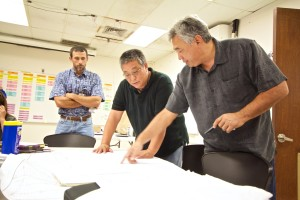 Hawaii Electric Light Company President Jay Ignacio, right, works with fellow HELCO staff on coordinating power restoration efforts on August 13, 2014. Photo courtesy of HECO.
