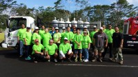 More than two dozen Hawaii Gas employees volunteered their time to help residents affected by Tropical Storm Iselle.