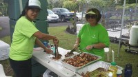 Hawaii Gas employees preparing meals for residents affected by Tropical Storm Iselle. Photos courtesy of Hawaii Gas.