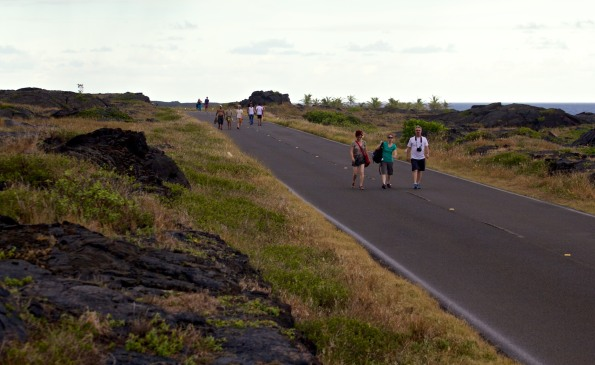 Visitors to Hawaii Volcanoes National Park walk along the closed section of Chain of Craters Road leading to the lava flow which cut-off access to Kaimu. Hawaii 24/7 File Photo