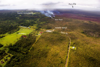 The June 27th lava flow remains active, and continues advancing towards the northeast on Friday, October 10, 2014. The flow front today was still narrow, about 185 m (roughly 600 feet) wide. The flow front today was 1.3 km (0.8 miles) upslope from Apaʻa St. and 2.4 km (1.5 miles) from Pāhoa Village Road. Photo courtesy of USGS/HVO