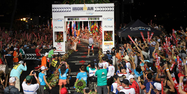 Mayor Billy Kenoi finishes the world championship triathlon. (Hawaii 24/7 photo by Karin Stanton)