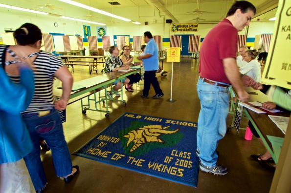 Voters at Hilo High School Cafeteria Tuesday (Nov 4) to cast their ballots in the General Election. Things appeared to be going smoothly in the early morning opening hour. Photography by Baron Sekiya | Hawaii 24/7