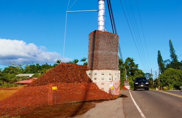 Utility pole hardened against the heat of the lava flow alongside Pahoa Village Road on Sunday, December 7, 2014. Protection material has been pushed off the roadway so it could open to traffic. Photography by Baron Sekiya | Hawaii 24/7