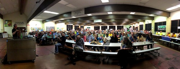 Steve Brantley of the USGS/HVO briefs the audience in the Pahoa High School Cafeterial during the lava flow update meeting Thursday night (Jan 8). Panoramic photo by Baron Sekiya | Hawaii 24/7