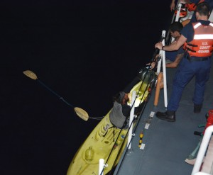 Crew members aboard Coast Guard Cutter Kiska, a 110-foot Island class patrol boat home ported in Hilo, rescue a distressed kayaker approximately 19 miles northeast of Kohala, Big Island, Jan. 13, 2015. The 38-year-old man left Maui en route Big Island when he became lost and called for assistance using his cell phone. Photo courtesy USCG