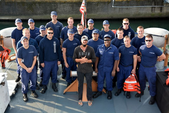 Crew members aboard Coast Guard Cutter Kiska pose with a distressed kayaker rescued from sea approximately 19 miles northeast of Kohala, Big Island, Jan. 14, 2015. The 38-year-old man left Maui en route Big Island when he became lost and called for assistance using his cell phone. Photo courtesy USCG