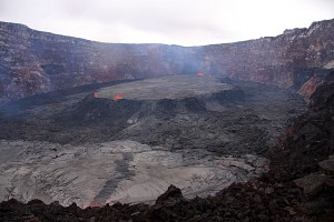 This textbook example of a perched lava lake that formed within the Pu'u 'Ō'ō crater in May 2011 shows what could happen with Kīlauea's current summit lava lake if overflows of the Overlook crater vent continue. Lava overflowing the vent rim could build a levee around the lake, increasing the height of the vent rim and resulting in a perched lava lake within Halema'uma'u Crater. USGS photo.