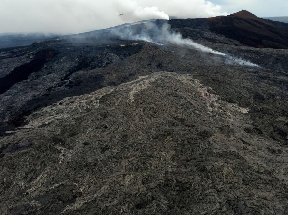 Active surface flows on the northeast flank of Pu'u 'Ō'ō on March 12, 2015. The activity is a continuation of a breakout that began on February 21, which diverted lava from the tube system and helped to starve the supply of lava to the June 27th flow front near Pāhoa. This breakout on Kīlauea is still active and has now reached 2.5 km (1.6 mi) northeast of Pu'u 'Ō'ō, but does not pose an immediate hazard to any community.  USGS photo.