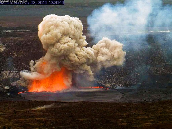 A portion of the Halemaʻumaʻu Crater wall collapsed at 1:20 p.m. Sunday, May 3, 2015, impacting the lava lake and triggering a small explosion of spatter and a robust particle-laden plume. Fist-size clasts were deposited around the closed Halemaʻumaʻu visitor overlook. Photo taken Sunday, May 3, 2015 courtesy of USGS/HVO