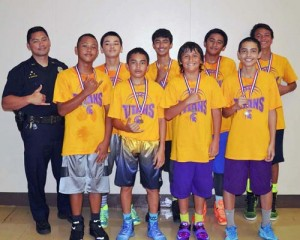 Waiākea Titans Gold: Front row, from left—Shesley Martines, Guyson Ogata, Kiaʻi Apele, Mikey Bugado. Back row—Officer Ryan Domingo, Rekky Prudencio, Magnus Namohala-Roloos, Kawai Kiko, Kilohana Haasenritter