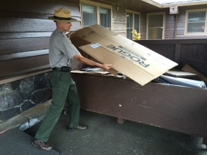 A Hawaii Volcanoes National Park ranger recycles cardboard at the Kilauea Visitor's Center. Photo courtesy of HVNP