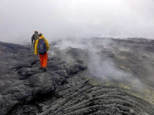 HVO geologists hike through thick fume and fog to reach the lava pond in the western portion of Puʻu ʻŌʻō crater. Photo taken Monday, September 28, 2015 courtesy of USGS/HVO
