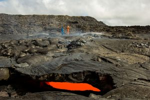 HVO geologists conduct a VLF (very low frequency) survey across the episode 61g lava tube to measure the depth and cross-sectional area of lava flowing within the tube. Photo taken Thursday, June 23, 2016 courtesy of USGS/HVO
