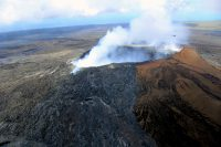 A wider view of the fume-filled crater at Puʻu ʻŌʻō. The deep hole near the crater rim (see photo at left) is just left of center in this image. Photo taken Friday, July 8, 2016 courtesy of USGS/HVO