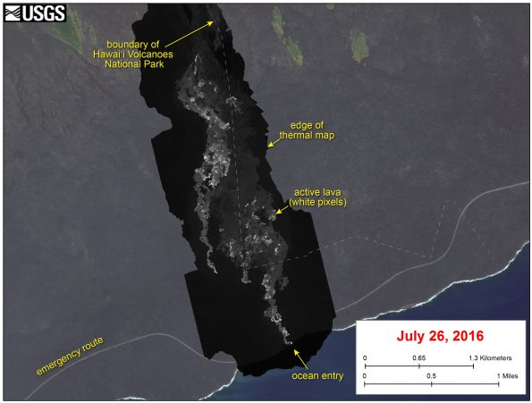 This image shows a thermal map of the flow on the pali and coastal plain, created from airborne thermal images. White pixels are hot, and show areas of active surface breakouts. The background image is a satellite image collected before the current lava flow was active.  The thermal map shows scattered pāhoehoe breakouts on the coastal plain, with a narrow lobe of lava crossing the gravel road and extending to the ocean. In addition, a narrow lobe was advancing along the western margin of the flow on the coastal plain.