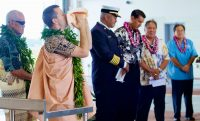 Kahu Kaliko Trapp, St. Joseph Catholic Church, sounds a conch shell during the dedication ceremony of the new fire station at Hilo International Airport Friday, July 29, 2016. Photography by Baron Sekiya   Hawaii 24/7