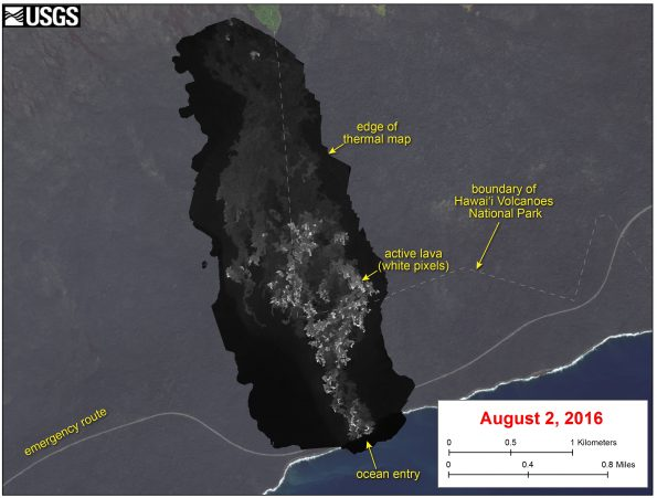 This image shows a thermal map of the flow on the pali and coastal plain, created from airborne thermal images. White pixels are hot, and show areas of active surface breakouts. The background image is a satellite image collected before the current lava flow was active. The thermal map shows scattered pāhoehoe breakouts on the coastal plain, with a narrow lobe of lava crossing the gravel road and extending to the ocean. The ocean entry has widened since it first formed on Tuesday, July 26, and now spans about 240 m (260 yards) of the coastline.