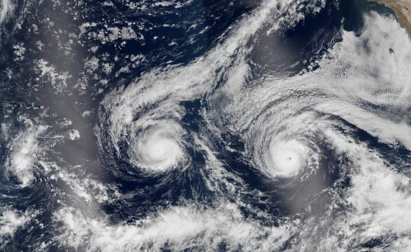 The natural-color image above is a composite built from two overpasses by the Visible Infrared Imaging Radiometer Suite (VIIRS) on the Suomi NPP satellite on August 29, 2016. At the time, Hurricane Madeline and Hurricane Lester were both hovering between category 3 and 4 storms. The bright streaks across the ocean surface (crossing Hawaii and Lester) are areas of sunglint, where sunlight reflected directly back at the VIIRS imager.