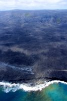 View of the 61g flow field, from Puʻu ʻŌʻō (visible on top, left horizon) to the westernmost ocean entry at the coast, where lava spills into the sea, creating a lava delta. Fume emanating from the flow field—on the coastal plain (above the ocean entry) and high on the pali (cliff) in the far distance—delineate part of the active tube system that carries lava from the Puʻu ʻŌʻō vent to the sea. Photo taken Thursday, September 1, 2016 courtesy of USGS/HVO