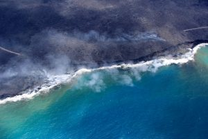 A closer view of where lava is entering the sea along a 1.1-km- (0.7-mi-) wide section of the coastline. There is no evidence that high surf from Hurricane Madeline had any impact on the lava deltas that have formed, and continue to grow, at the ocean entries. Discoloration of the ocean water is caused by fragments of volcanic glass, which are produced when hot lava enters cool seawater and shatters into tiny pieces that are carried by currents along the shore. Photo taken Thursday, September 1, 2016 courtesy of USGS/HVO