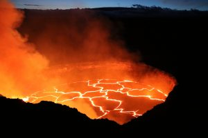 A view of the lava lake in Halemaʻumaʻu Crater at dusk, taken from the rim of Halemaʻumaʻu (closed to the public due to volcanic hazards). The view is towards the northwest, with the broad summit of Mauna Loa near the top of the photograph. The lake was 34 meters (112 feet) below the Overlook crater rim at this time. Photo taken Wednesday, September 28, 2016 courtesy of USGS/HVO