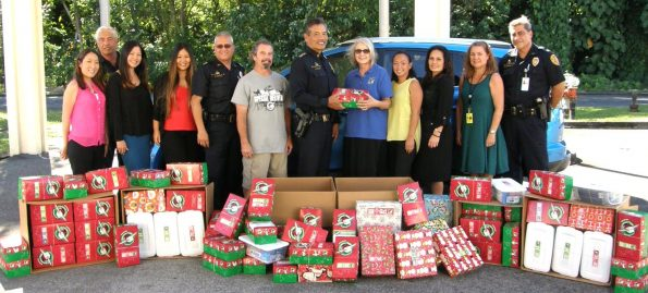 Employees from the Hawaiʻi Police Department donated 136 boxes of Christmas gifts destined for children in need around the world. The boxes were presented to representatives of Operation Christmas Child on Thursday (November 17) at the South Hilo police station. Operation Christmas Child is a yearly community project that reaches out to children in need who have never experienced the kindness of receiving a gift. Shoebox gifts are collected around the state in this international effort to assist those in war torn countries or suffering from famine, sickness and poverty.