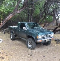 The Coast Guard is searching for two possible persons in the water off of the Big Island, five miles north of Kawaihae and the Kohala district, Dec. 4, 2016. A green Nissan truck and trailer believed to belong to one of the boaters was left at the campsite. (Courtesy photo/Released)