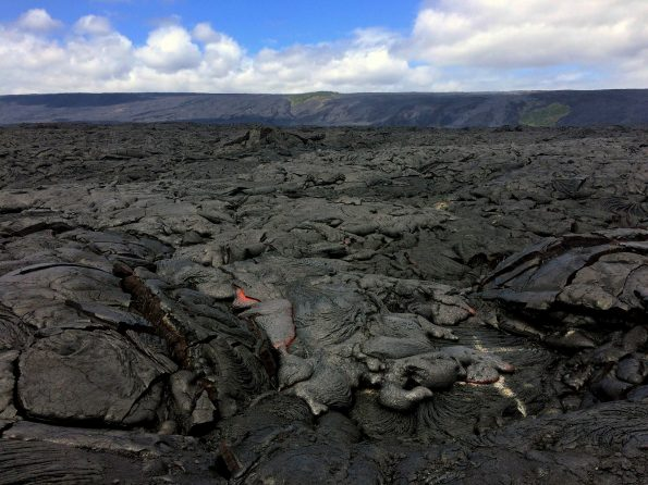 Wednesday (February 22, 2017), the breakout along the eastern edge of Kīlauea Volcano's episode 61g flow remains active and had advanced approximately 570 m (620 yards) since it was last mapped on February 14. The flow front consisted of sluggish, oozing pāhoehoe that was approximately 730 m (0.5 miles) from the ocean and 540 m (0.3 miles) from the emergency route road. Channelized lava flows have been recently reported on Pūlama pali, but no active channels were seen by HVO geologists while working in the area this afternoon. They did, however, observe scattered breakouts on the pali. Photo taken Wednesday, February 22, 2017 courtesy of USGS/HVO