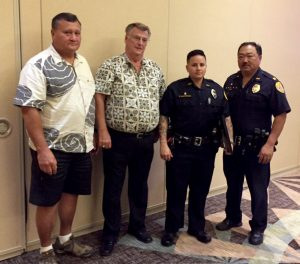 Pictured from left to right: Robert Hickox of Kohanaiki, Randy Crowe of R. Crowe Consulting, Officer Sidra Naki-Brown, and Captain Randal Ishii