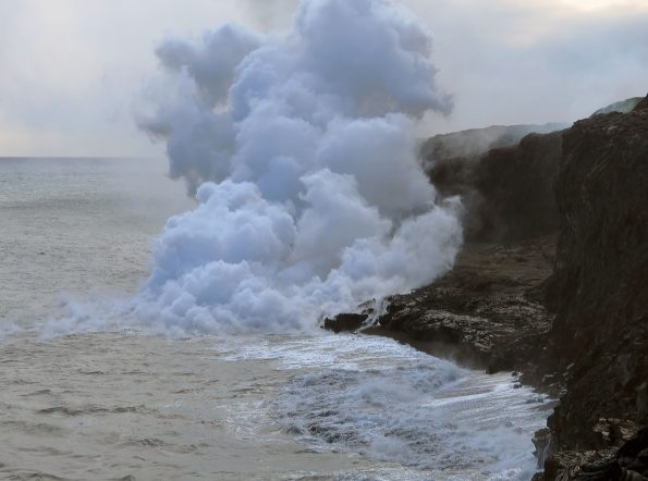 The ocean entry at Kamokuna remains active, with a small lava delta. Views of the lava streams entering the water were obscured by the thick plume. Very weak littoral explosions were occurring. Photo taken Saturday, April 15, 2017 courtesy of USGS/HVO