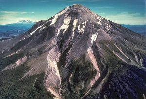 Before the eruption of May 18, 1980, Mount St. Helens' elevation was 2,950 m (9,677 ft). View from the west, Mount Adams in the distance. S. Fork Toutle River is the valley in the center of the photo. Photo taken 1979 courtesy of USGS.